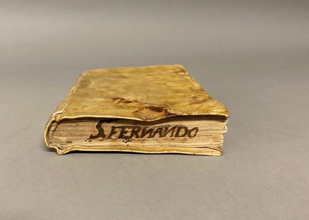 Marca de Fuego of the Colegio de San Fernando on the text block Juan Bautista's Advertencias para los confesores de los naturales, Parte 1 (1600), Kenneth Spencer Research Library Call Number: B620.