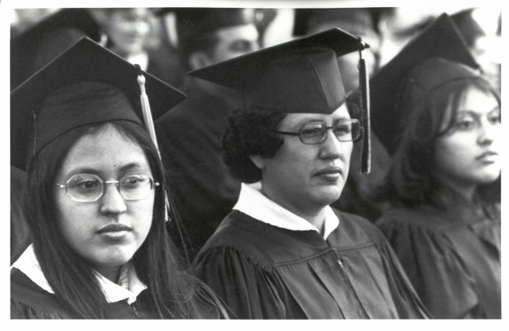 Photograph of graduates Angela and Salina Gonzales, with their mother Lydia, at a commencement ceremony in Garden City, Kansas, circa 1970