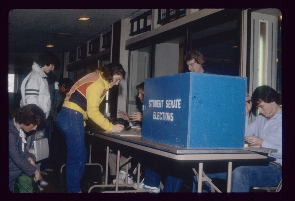 Photograph of KU students voting in student elections, 1980
