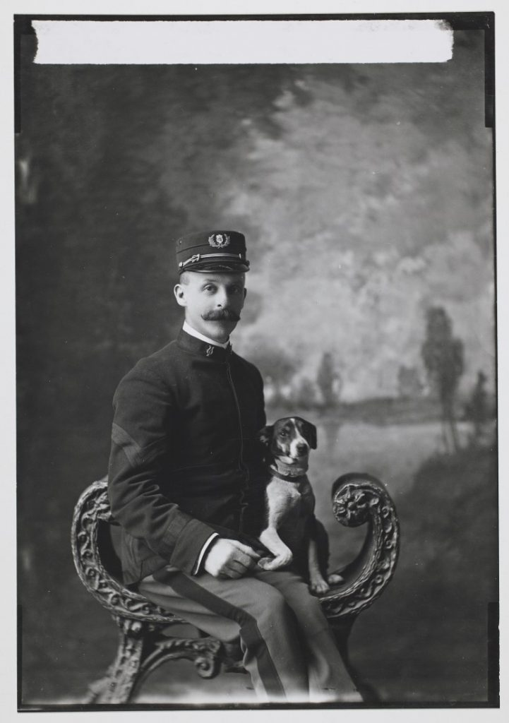 Portrait of Sgt. Blake (Fourth Cavalry Band) with a dog, 1901