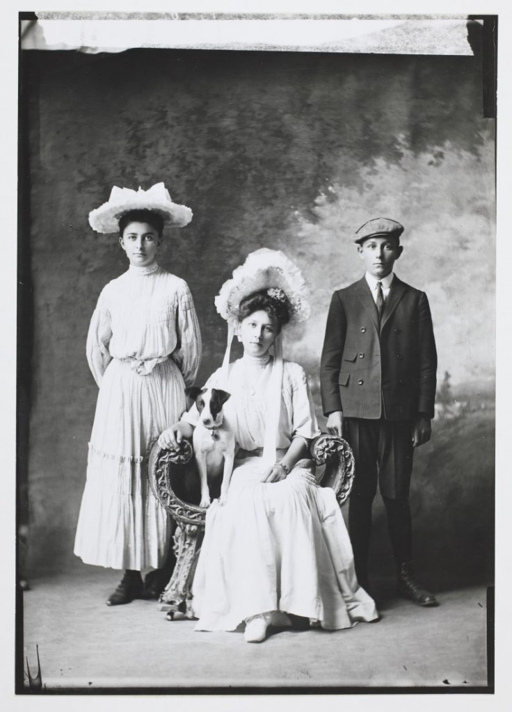 The Newman siblings with a dog, 1905