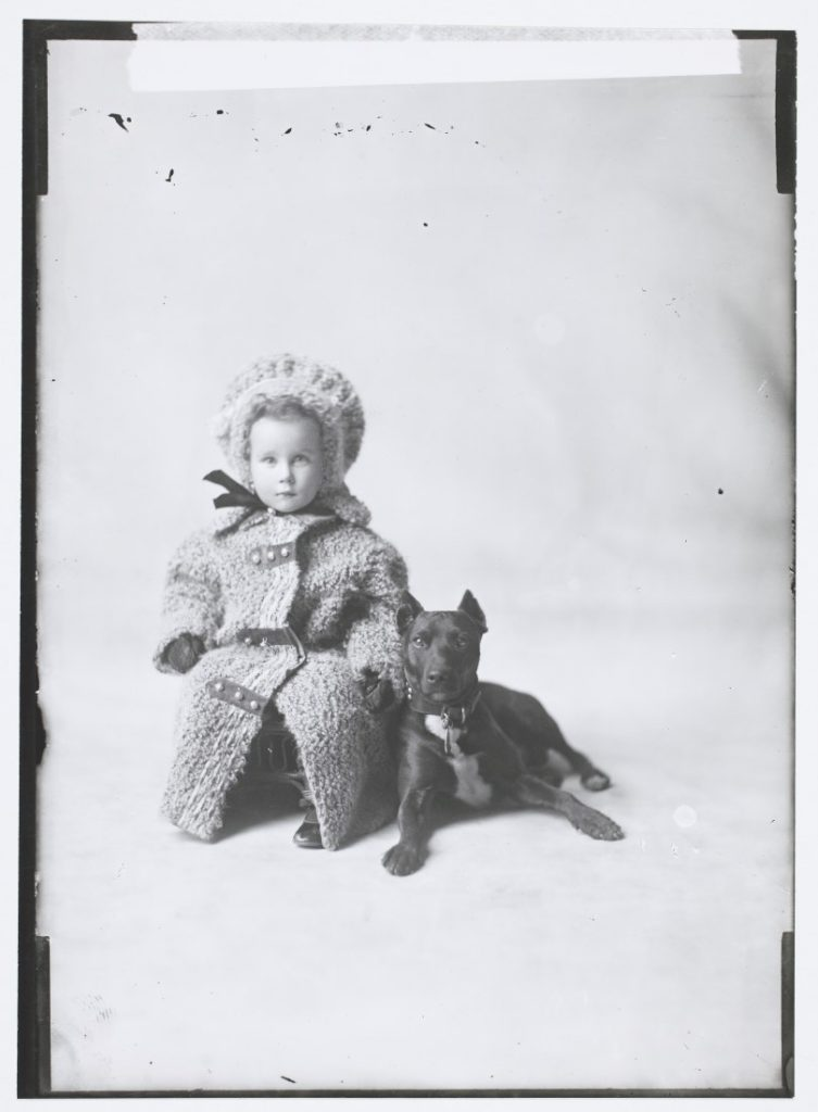 Portrait of Lieut. G. L. Morrison's child with a dog, 1908