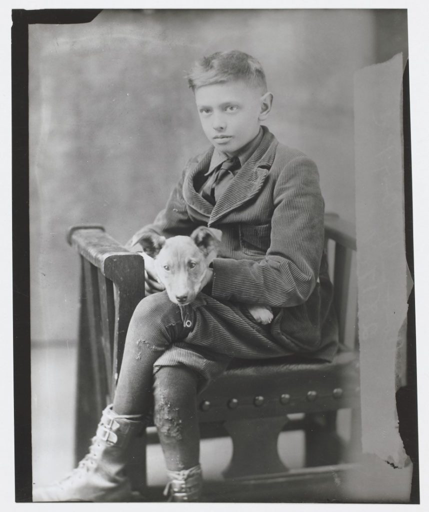 Portrait of Robert Carr and a dog, 1919