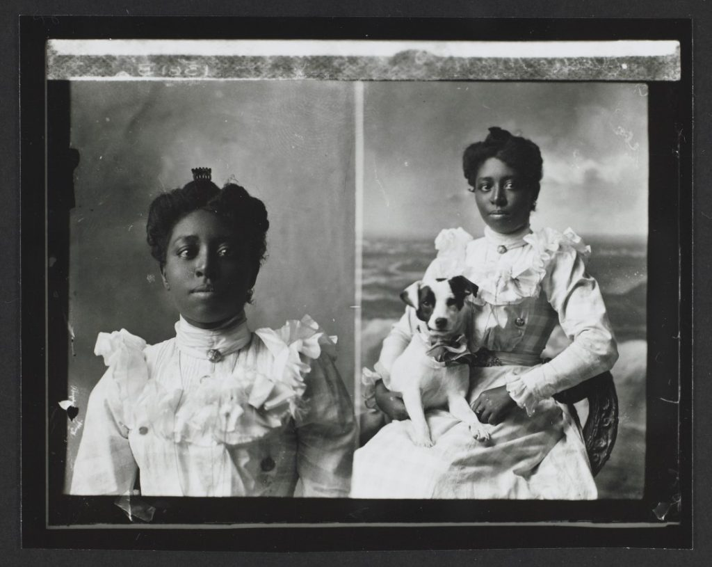 A double portrait of Ellen Marks holding a dog, 1899