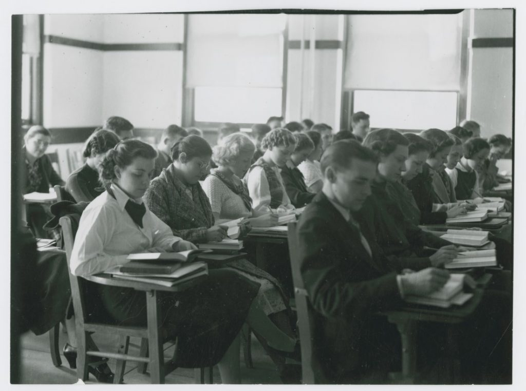 Photograph of KU students taking a test, 1935-1936