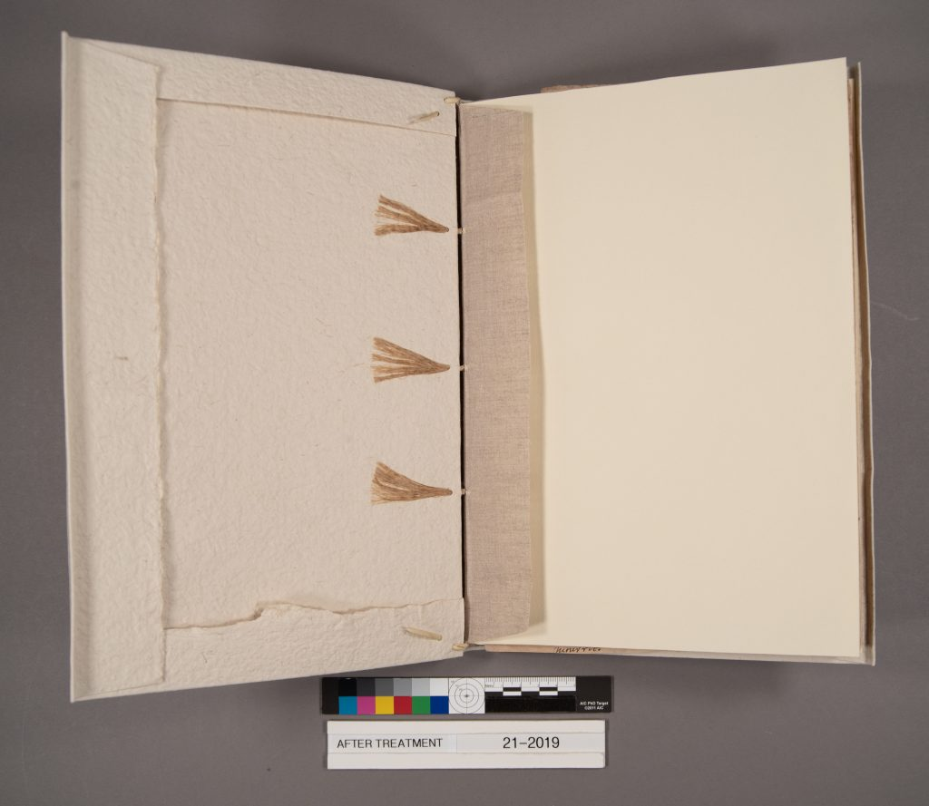 MS E279 after treatment in its new paper case binding, with linen spine lining and laced sewing supports.