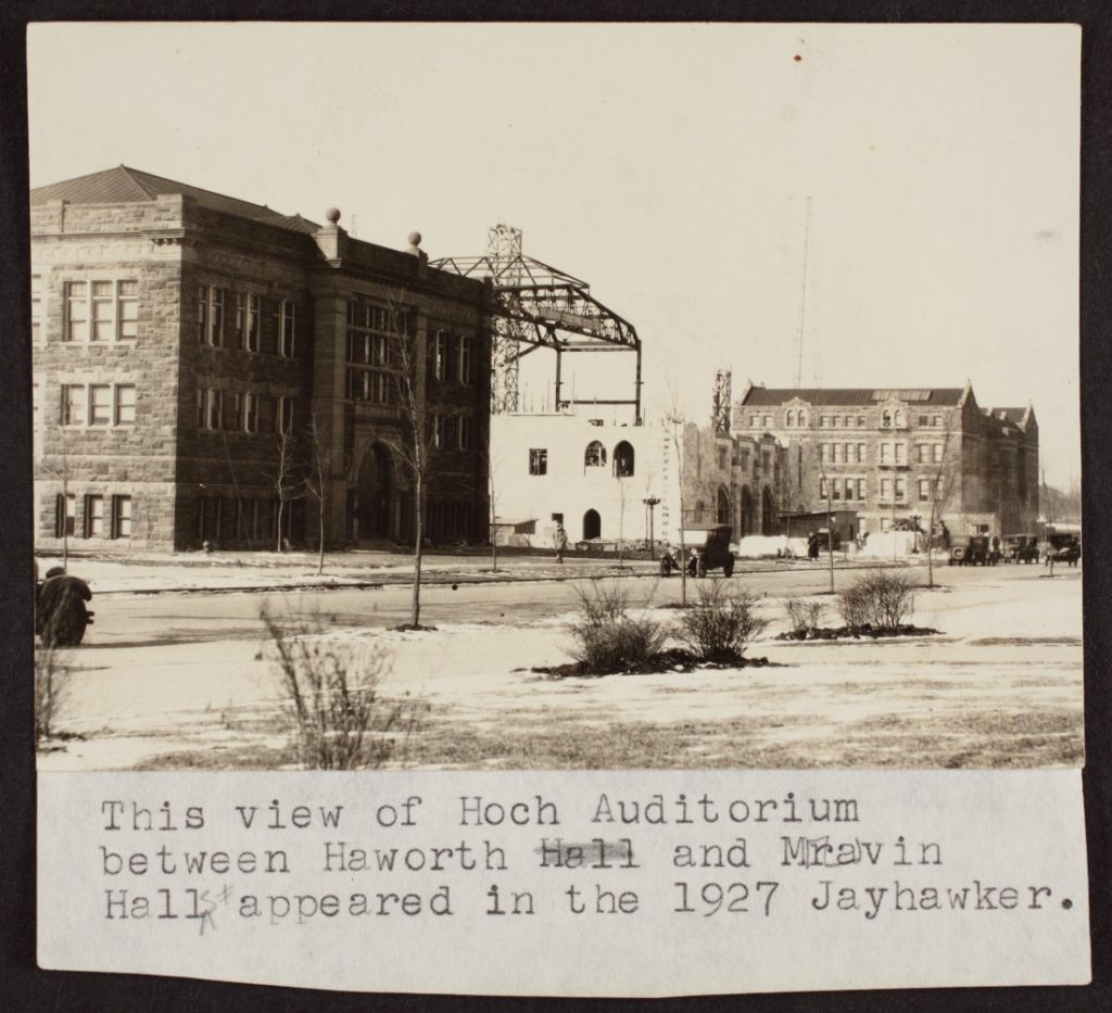 Black-and-white photograph of Hoch Auditorium with the ground level exterior completed and the building's frame above it.