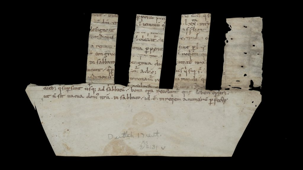 Picture of a manuscript fragment from from Amalarius of Metz's De ecclesiasticis officiis libri quatuor used as a comb spine binding (recto side, formerly designated as verso), Germany?, around 900. Call # MS 9/2:31.