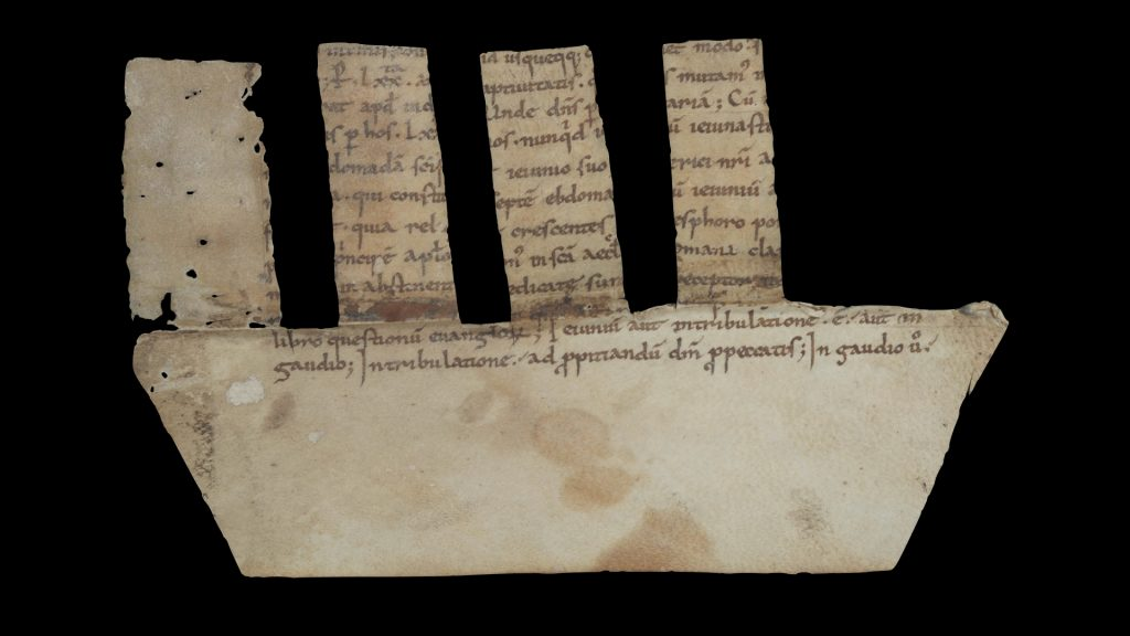 Picture of a manuscript fragment from from Amalarius of Metz's De ecclesiasticis officiis libri quatuor used as a comb spine binding (verso side, formerly designated as recto), Germany?, around 900. Call # MS 9/2:31