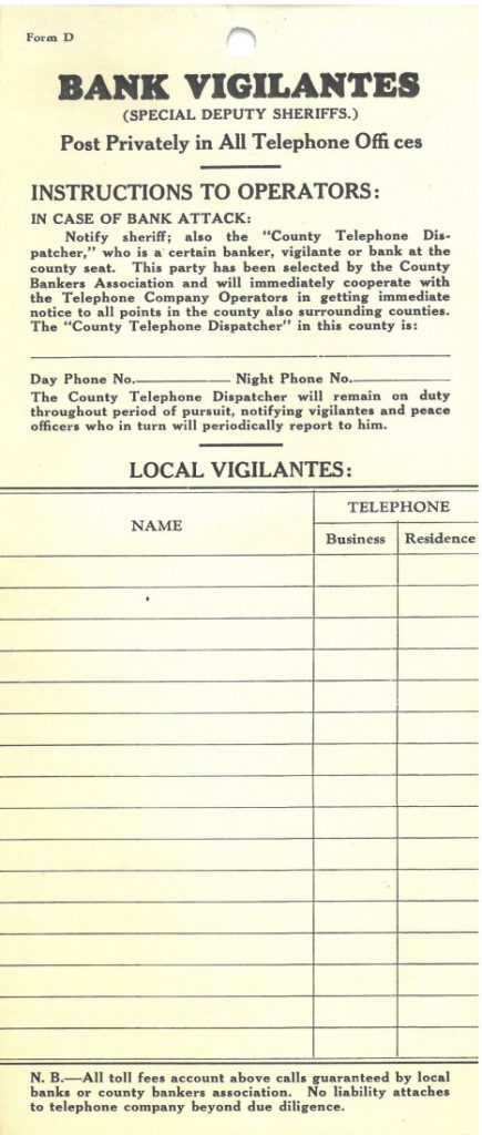 A vertical form with instructions to operators in case of a bank attack and a grid to record names and phone numbers.